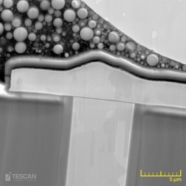 Magnified image of a Cu TSV showing the solder bump, passivation layer, mold compound and liner oxide layer